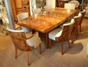 A grand example of an Art Deco Dining Table and matching dining chairs from the 1930s. The table and chairs are typically finished in high quality figured Walnut veneers.