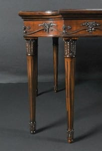 An example of fluted Mahogany legs supporting a 19th Century French Empire serving table.