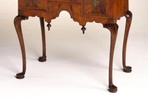 A Walnut Queen Anne Lowboy Writing Table raised upon slender Cabriole legs with simple pad feet.