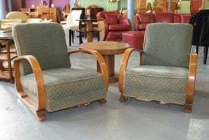A pair of Art Deco 'Easy' Arm Chairs produced by Heal & Son. The sweeping Arm design made this style of chair iconic today.